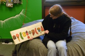"A children's-literature student reads ""The Very Hungry Caterpillar"" to pre-K and kindergarten students."