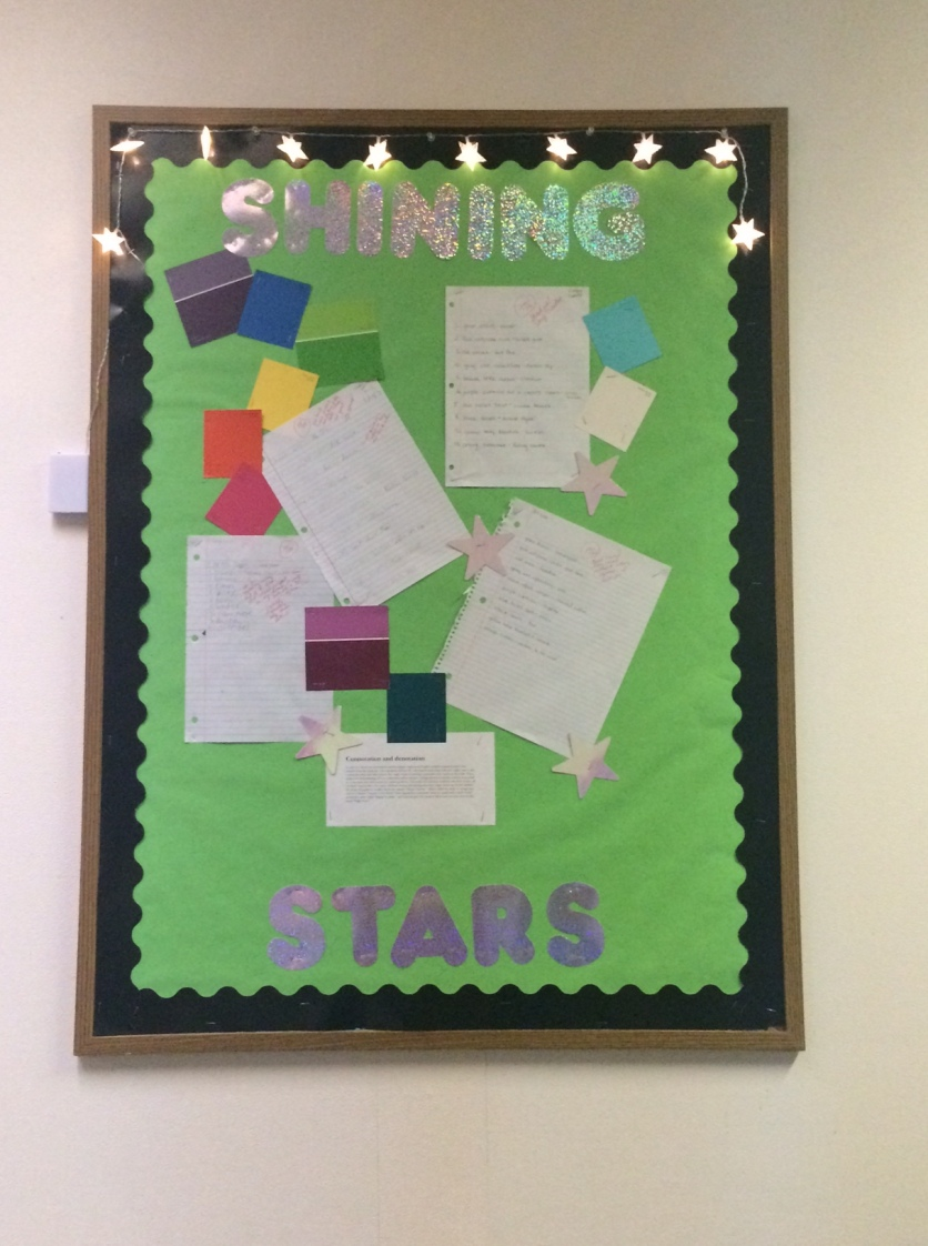 This board showcases student work in the hall.